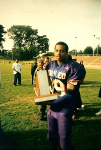 Zuri Berry holds the Academic Athletic Association trophy for San Francisco section prep football after the Galileo Lions defeated the Washington Eagles 28-21 in the Thanksgiving day championship, 2001.