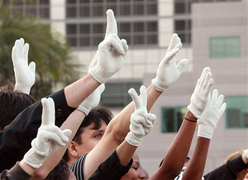 Fans hold up a sea of single gloved hands in an impromptu celebration of the life of Michael Jackson, outside UCLA Medical Center after he was pronounced dead there in Los Angeles.