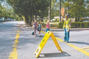 "Michael Malakian, a teacher at Deer Creek Elementary, mans the crosswalk at Zion Street Wednesday afternoon. The Nevada City School District will be putting three flashing crosswalks on the Zion Street as part of its ""Safe Routes to School"" improvements. Photo by John Hart"